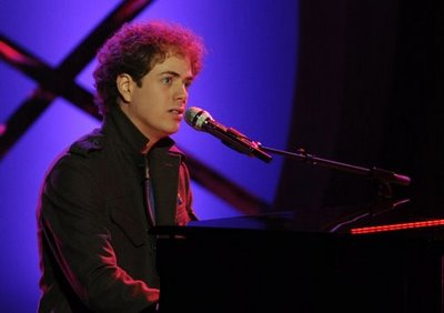 Scott sings and plays the piano- what a guy!