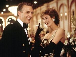 Lt. Cmdr. Tom Farrell (Kevin Costner) & Susan (Sean Young)