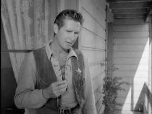 "As  a deputy in ""High Noon"""