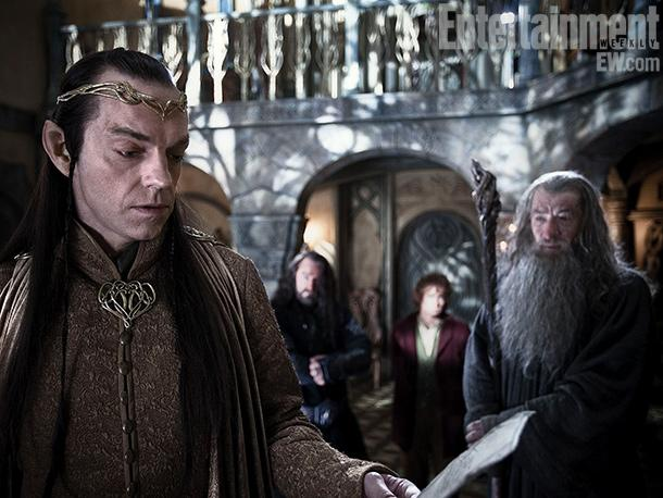 Hugo Weaving as Elrond examines map