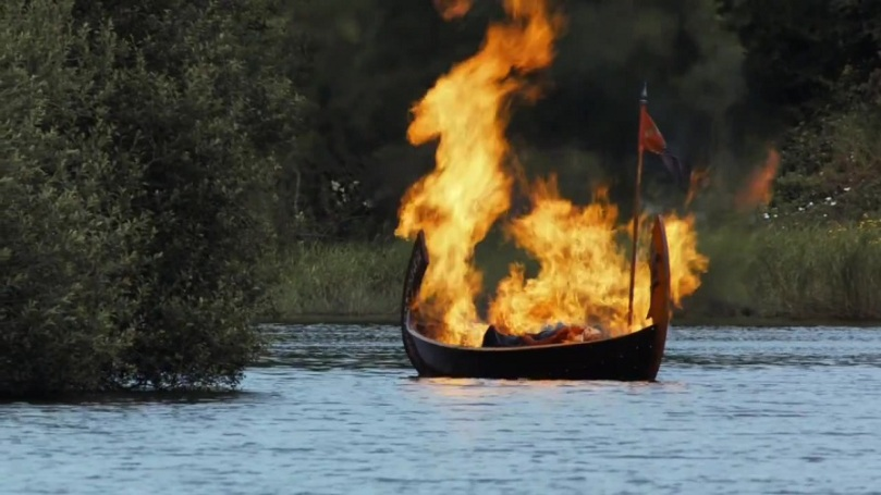 The boat carrying Sir Hoster Tully's corpse is set aflame.