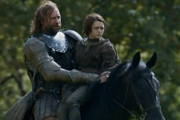 The Hound and Arya ride toward The Twins