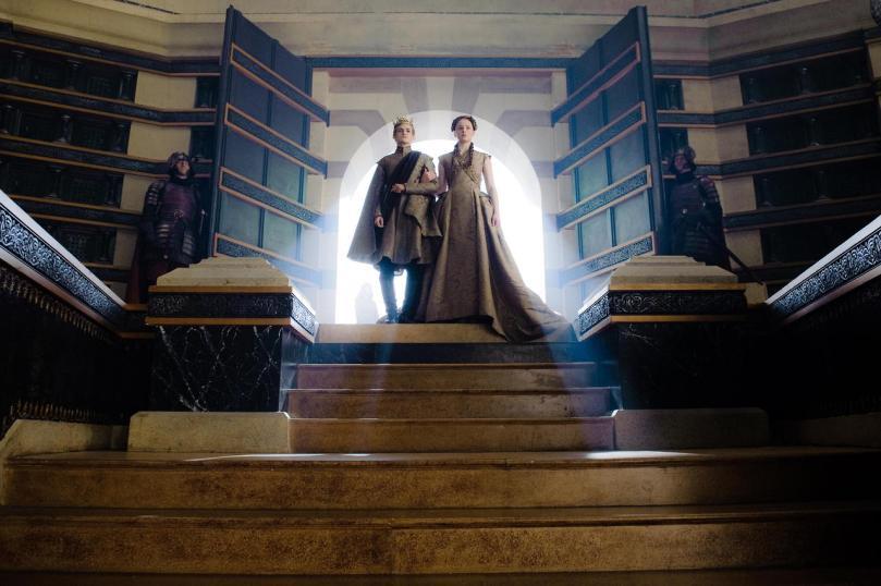 King Joffrey walks Lady Sansa down the aisle