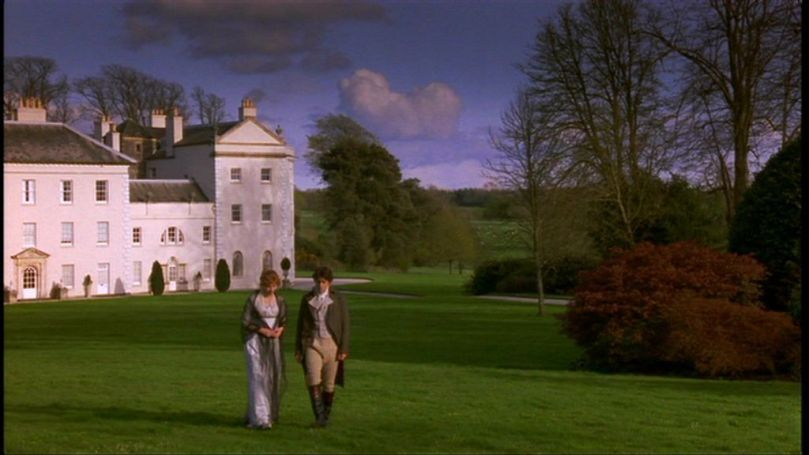 Elinor (Emma Thompson) and Edward (Hugh Grant) stroll through Norland in director Ang Lee's 1995 film.
