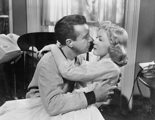 The professor (Dick Powell) and his wife (Gloria Grahame)