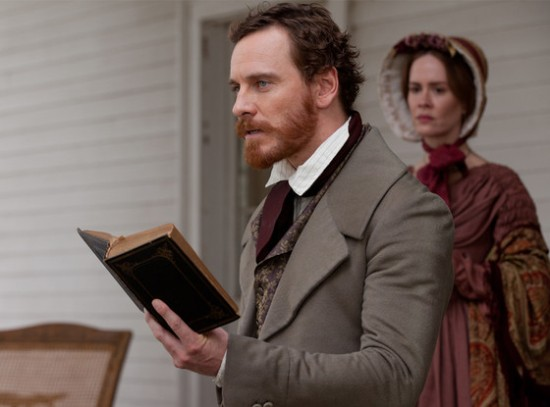 Edwin Epps (Michael Fassbender) reads The Bible while his wife (Sarah Paulson) looks on