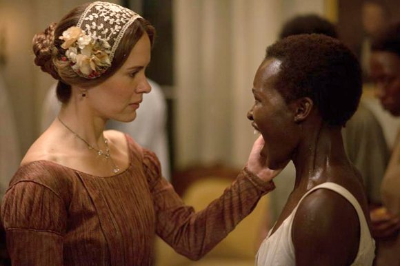 Mistress Epps scratches the face of Patsey (Lupita Nyong'o)