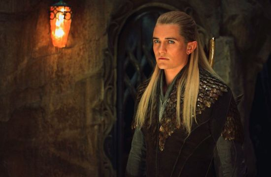 Legolas (Orlando Bloom) listens to Tauriel & Kili