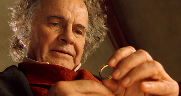 Bilbo (Ian Holm) examines the ring