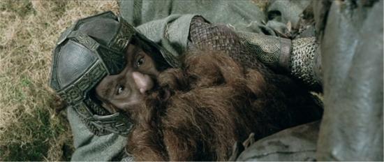 Gimli (John Rhys-Davies) provides some much-needed humor