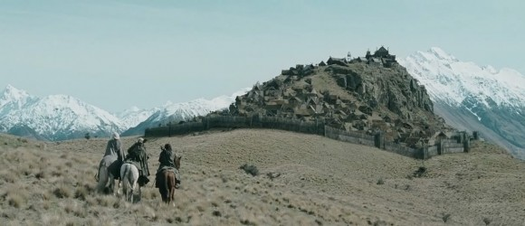 Aragorn, Gimli, and Legolas riding toward Edoras