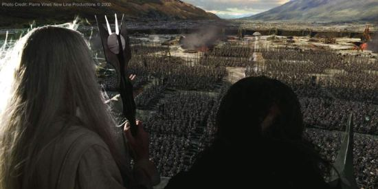 Saruman (Christopher Lee) and Grima (Brad Dourif) atop Isengard looking over the army