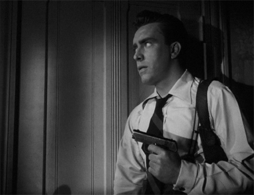 Jim Riordan (Edmond O'Brien) investigates the why of the murder