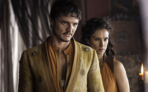 GAME OF THRONES season 4: Pedro Pascal, Indira Varma. photo: Helen Sloan
